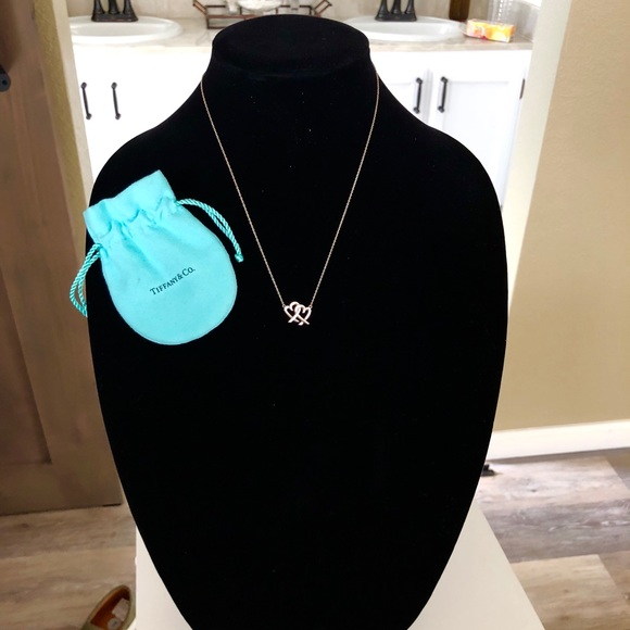 900072f8c Tiffany & Co Loving Heart interlocking pendant. M_5bc8fa7ba31c33f18d332794